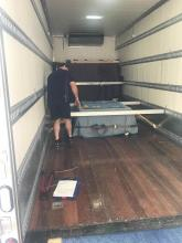 Careful placement of crate on truck for transport