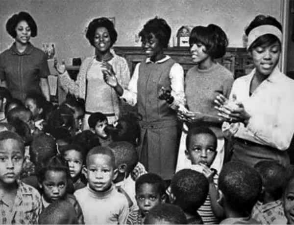 old photo of african american teachers and students in a classroom