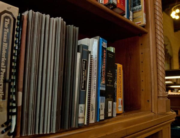 books on a shelf at the architecture and planning library