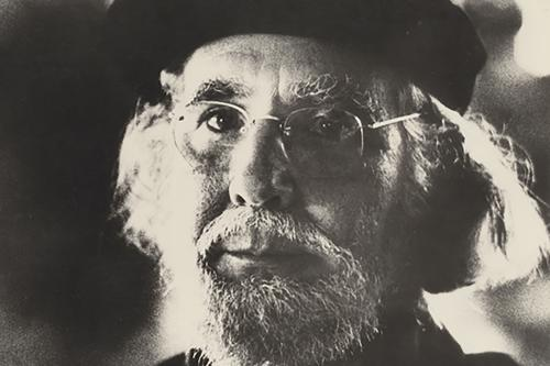 ernesto cardenal, man in black turtleneck with glasses and white beard.