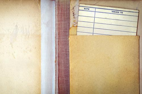 library book open to frontispiece with checkout card visible