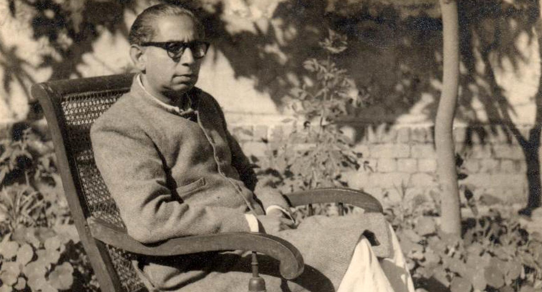 urdu writer sajjad zaheer reclining in chair. black and white.