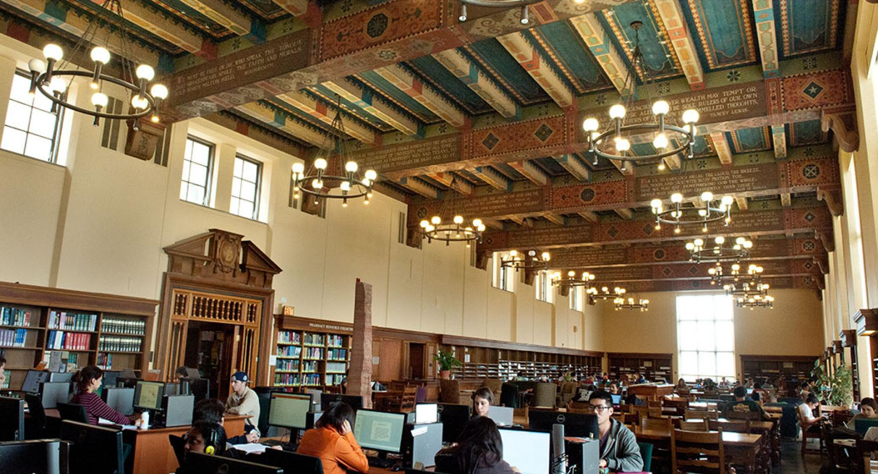 students working in traditional library space at the life science library