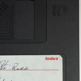 detail of a Maxell 3.5 inch floppy disk with Spanish writing on the label