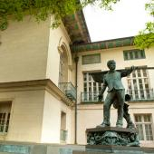 Exterior view of Battle Hall featuring the statue of Cesar Chavez.