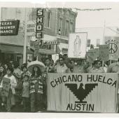 protestors holding sign that reads Chicano Huelga Austin