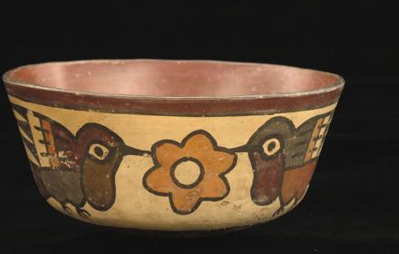 colombian pottery artifact bowl with hummingbird design
