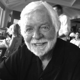 black and white image of man smiling at camera
