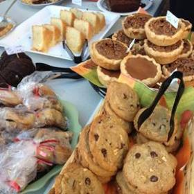 plates and baskets of sweets and cookies
