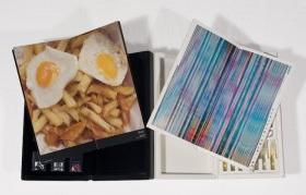 Two open books with spreads of eggs on fries and blue stripes